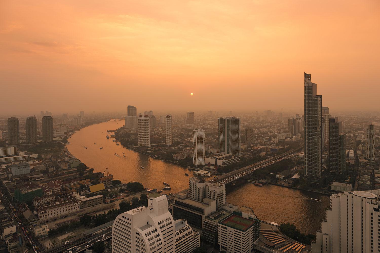 Hazy Sunset over the Chao Phraya River and the Bangkok Skyline (Thailand)