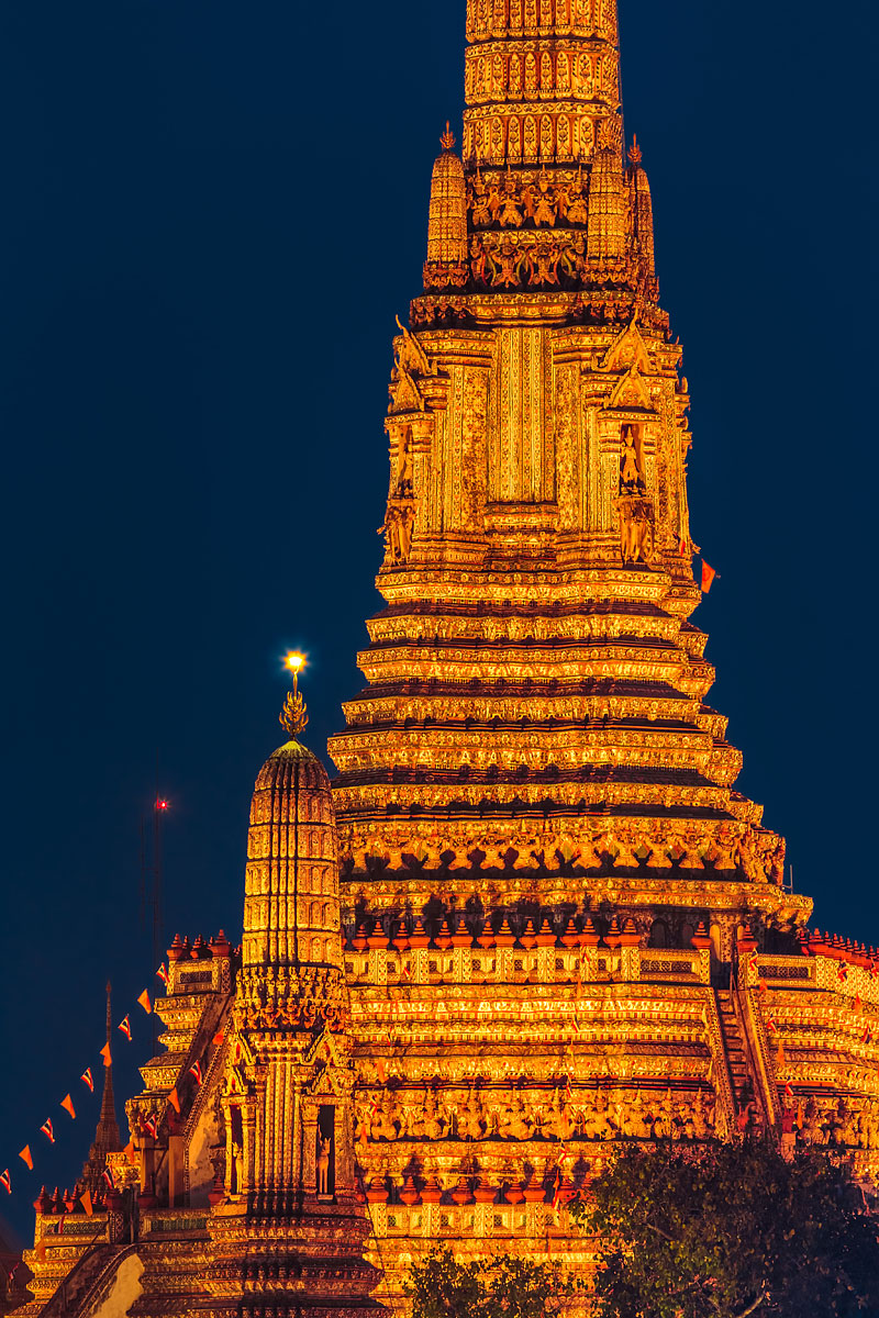 Night View of the Buddhist Temple of Dawn (Wat Arun) in Bangkok, Thailand, Southeast Asia. Taken from the other side of the Chao Phraya river with a telezoom lens.