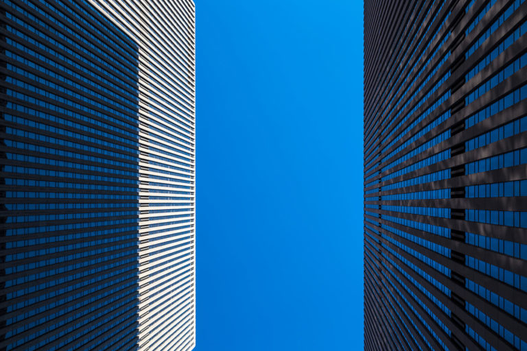 New York City - Upward View of Two Skyscrapers in Manhattan
