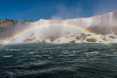 As sunlight reflects off the mist created by the Falls, visitors standing at the right angle can observe beautiful rainbows. The American Falls is one of the waterfalls that together are known as Niagara Falls. It is much smaller than the Canadian Falls, a.k.a. the Horseshoe Falls.