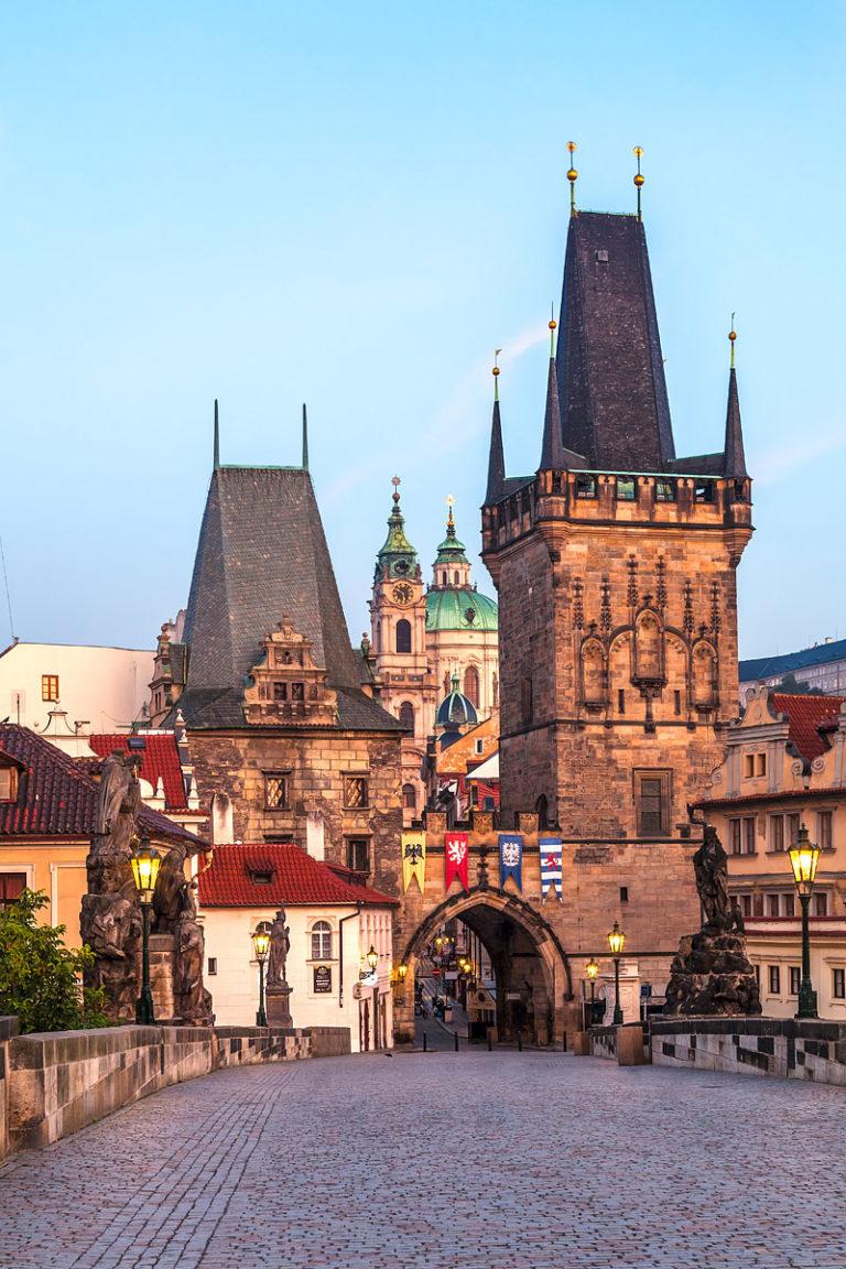 The Lesser Town Bridge Tower (Malostranská mostecká věž) and the Charles Bridge (Karlův most) at Sunrise, Prague, Czechia