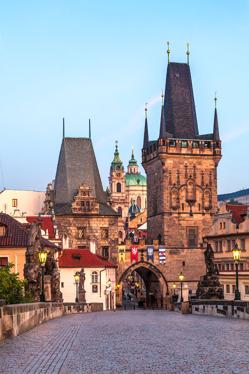 The Lesser Town Bridge Tower (Malostranská mostecká věž) and the Charles Bridge (Karlův most) at Sunrise, Prague, Czechia