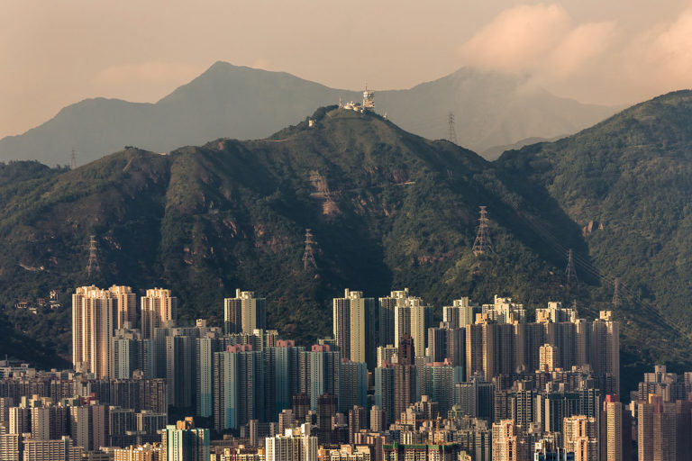 Highrise Apartment Buildings in Kowloon, Hong Kong and the Neighbouring Mountains as Seen from Victoria Peak