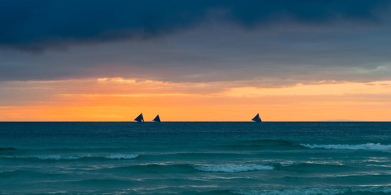 Boracay, the Philippines - Filipino Paraw Sailboats at Sunset